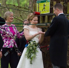 Go Ape Bride and Groom Exchange Rings at Wedding Ceremony in the Trees