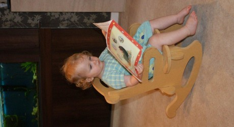 31549_Maggie-reading-in-rocking-chair