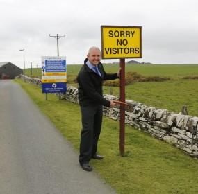 Brian MacAulay Removes Visitor Centre Sign at Scapa Distillery