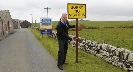 Brian MacAulay Removes Visitor Centre Sign at Scapa Distillery