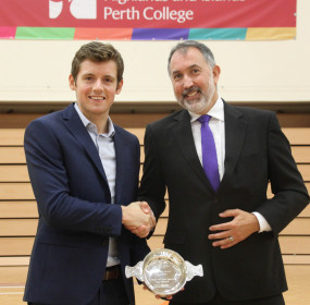 Greg Lobban being presented with his award by Dr Iain Morrison