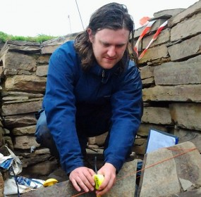 Neil Ackerman investigating the Ness of Brodgar slates
