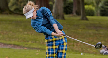 Female golfer in My Name'5 Doddie tartan